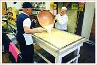 Reg pours the fudge mixture onto a marble slab